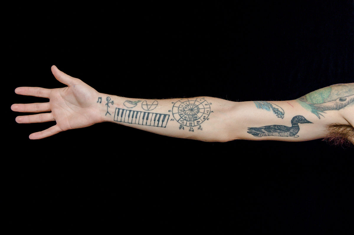 6cd93ce3a Musicians' Tattoos: Ink Tells the Tale